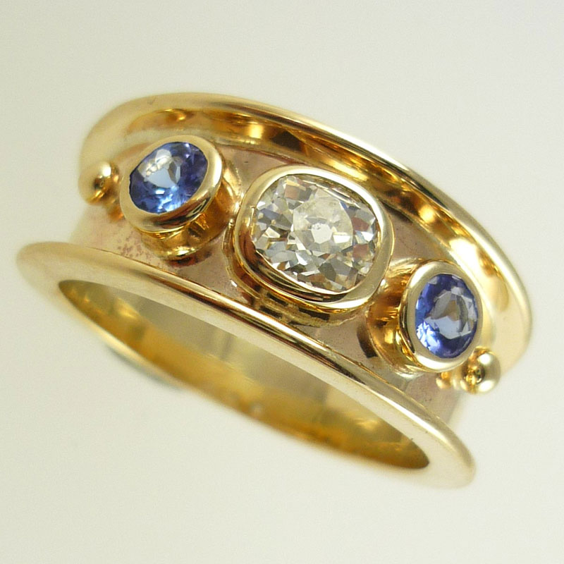 Clients-old-cut-diamond-flanked-by-new-tanzanites Examples of re-design commissions