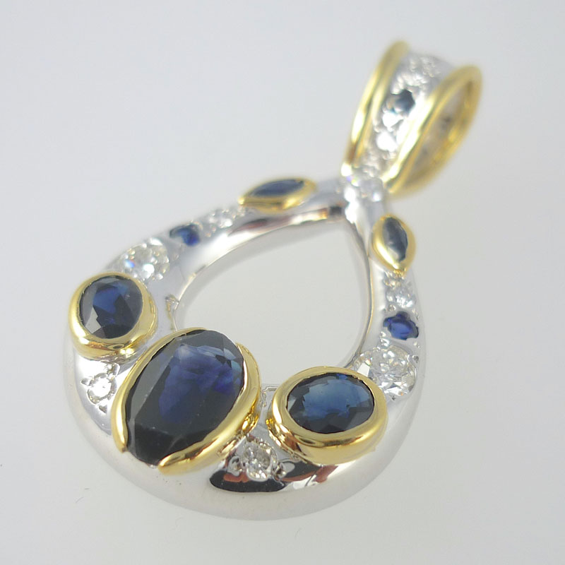 Sapphire-and-diamond-statement-pendant Gold Pendant set with Diamond and Sapphire