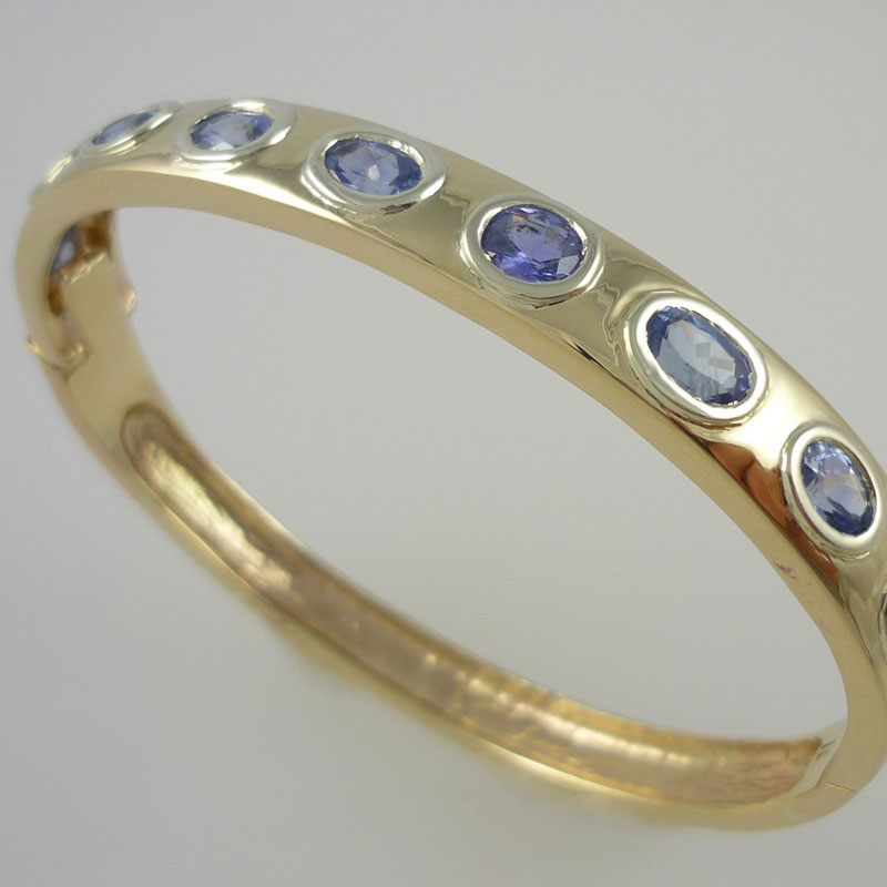 Sapphire-bangle-in-white-yellow-gold 9 Carat Gold Bangle with Sri Lankan Sapphires