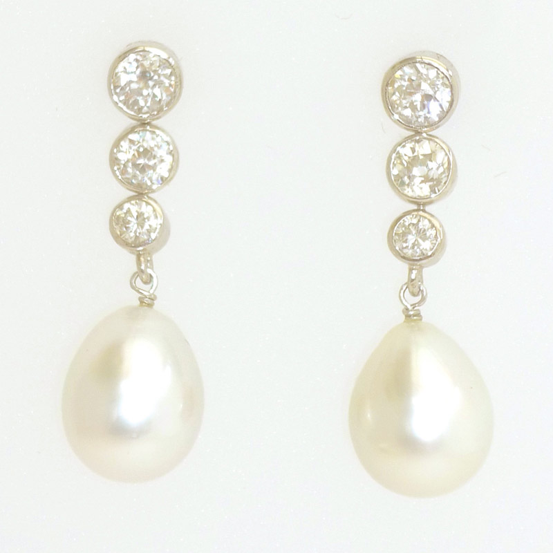 Graduated-diamond-and-South-Sea-Pearl-drop-earrings Earrings